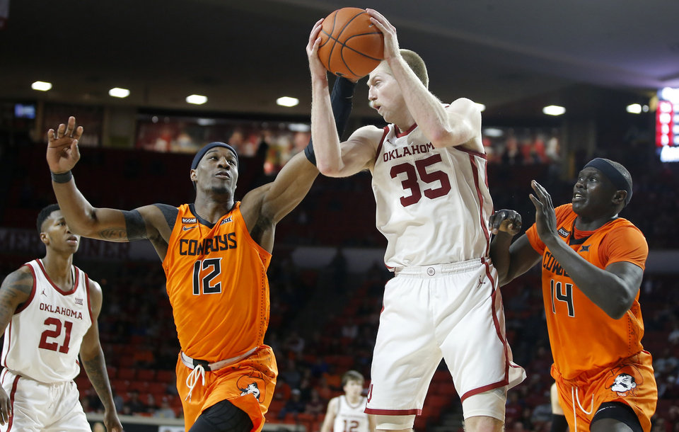 Photo - Oklahoma's Brady Manek (35) gathers the ball between Oklahoma State's Cameron McGriff (12) and Yor Anei (14) during a Bedlam college basketball game between the University Oklahoma Sooners (OU) and the Oklahoma State Cowboys (OSU) at the Lloyd Noble Center in Norman, Okla., Saturday, Feb. 1, 2020. Oklahoma won 82-69. [Bryan Terry/The Oklahoman]