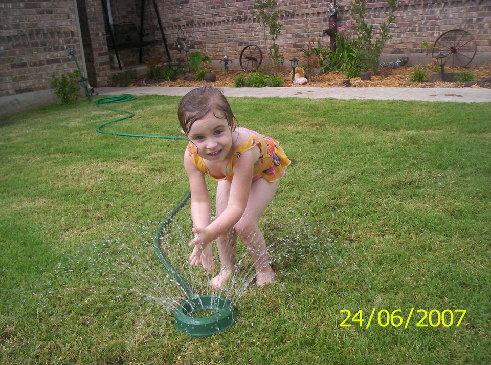 Alysia playing in the sprinkler there is a new song out it's country says. she was playing cinderella.. and it reminds me of Alysia ..<br/><b>Community Photo By:</b> Aunt Tama<br/><b>Submitted By:</b> Tama, Midwest