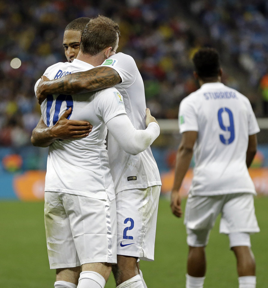 Photo - England's Wayne Rooney is hugged by England's Glen Johnson after Rooney scored his side's first goal during the group D World Cup soccer match between Uruguay and England at the Itaquerao Stadium in Sao Paulo, Brazil, Thursday, June 19, 2014. Uruguay defeated England 2-1. (AP Photo/Kirsty Wigglesworth)
