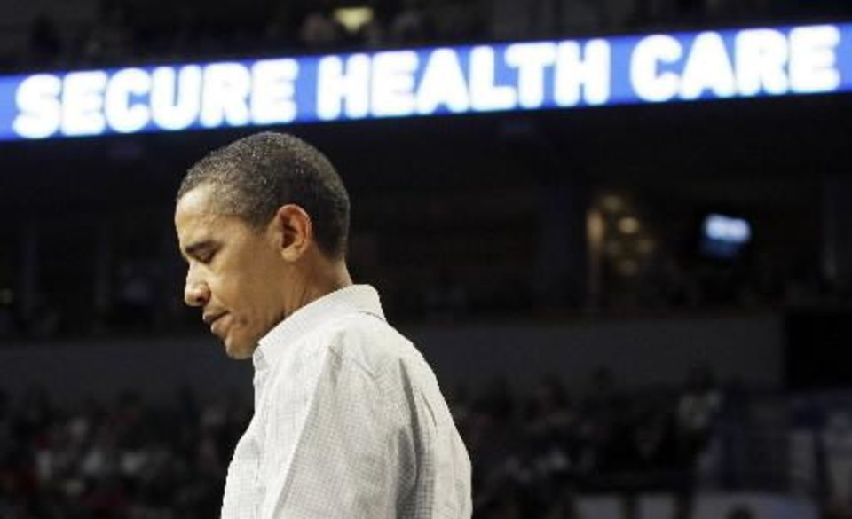 President Barack  Obama pauses during a  health insurance reform rally, Saturday, Sept. 12, 2009, in Minneapolis. (AP Photo/Haraz N. Ghanbari)