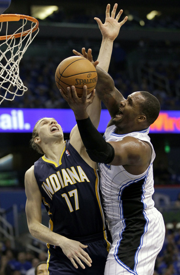Photo -   Orlando Magic's Glen Davis, right, makes a shot past Indiana Pacers' Louis Amundson (17) during the first half of Game 3 of an NBA first-round playoff basketball series, Wednesday, May 2, 2012, in Orlando, Fla. (AP Photo/John Raoux)