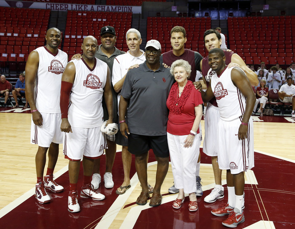 "Photo - All American and 2000 plus scorers are introduced as the University of Oklahoma Sooners (OU) basketball alumni play at The Lloyd Noble Center on Saturday, Aug. 24, 2013  in Norman, Okla. Left to right are Harvey Grant, Darryl ""Choo"" Kennedy, Stacey King, Alvan Adams, William Tisdale (representing his deceased brother Wayman), Blake Griffin, Jane Lane Warner (representing her husband Lester Lane), Eduardo Najera, and Hollis Price.   Photo by Steve Sisney, The Oklahoman"