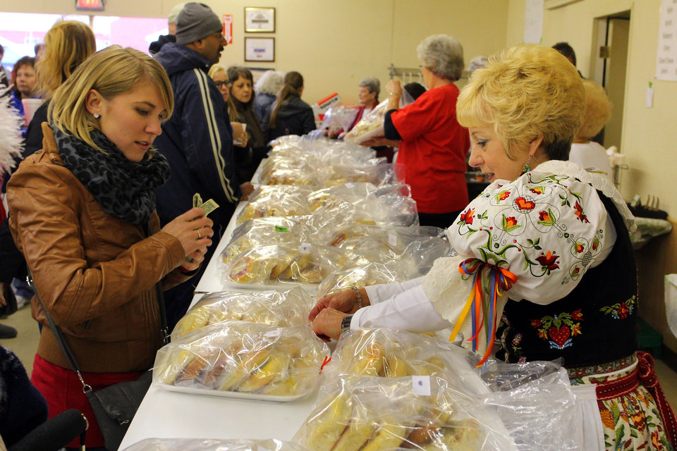 Janice VanBrunt bags up an order of kolaces for a customer during the 47th annual Czech Festival Saturday in Yukon. PHOTO BY HUGH SCOTT FOR THE OKLAHOMAN