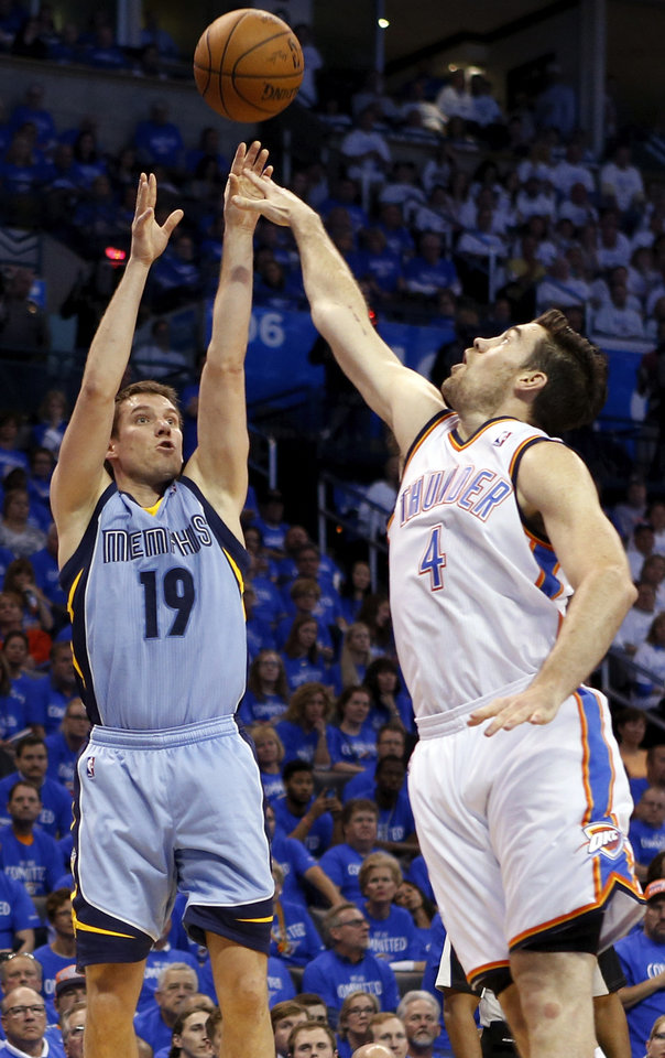Photo - Memphis' Beno Udrih (19) shoots against Oklahoma City's Nick Collison (4) during Game 2 in the first round of the NBA playoffs between the Oklahoma City Thunder and the Memphis Grizzlies at Chesapeake Energy Arena in Oklahoma City, Monday, April 21, 2014. Memphis won 111-105 in overtime. Photo by Nate Billings, The Oklahoman