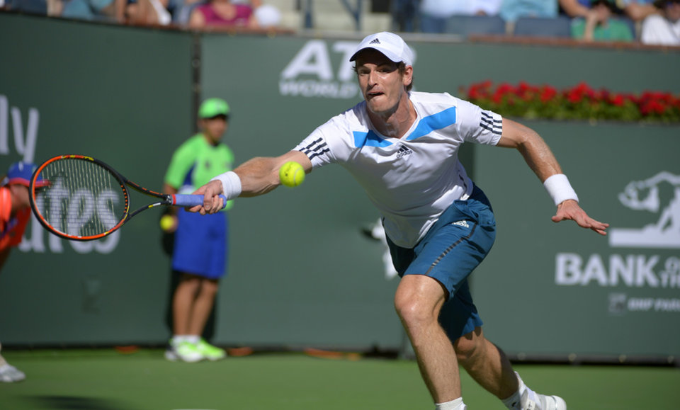 Photo - Andy Murray, of Great Britain, returns a shot to Lukas Rosol, of the Czech Republic, during their match at the BNP Paribas Open tennis tournament, Saturday, March 8, 2014, in Indian Wells, Calif. (AP Photo/Mark J. Terrill)