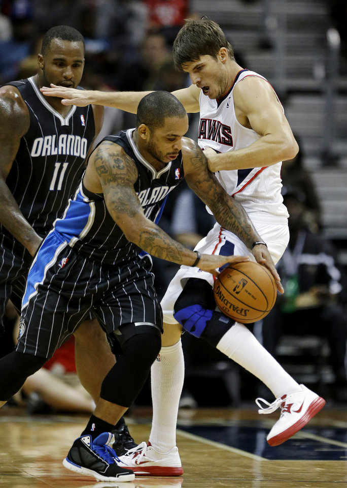 Orlando Magic's Jameer Nelson, left, dribbles against Atlanta Hawks' Kyle Korver in the second quarter of an NBA basketball game, Monday, Nov. 19, 2012, in Atlanta. (AP Photo/David Goldman)