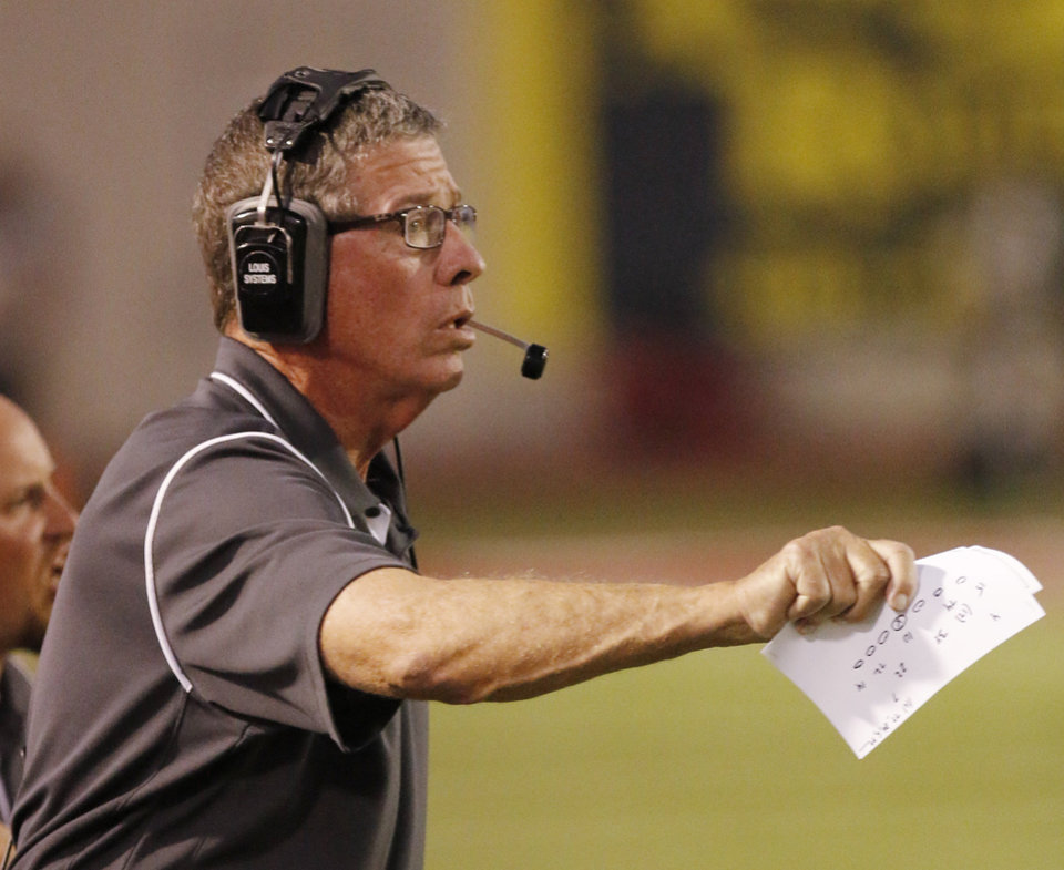 Photo - Carl Albert head coach Gary Rose watches the action  during the high school football game between Guthrie at Carl Albert in Midwest City, Friday, October 11, 2013.  Photo by Doug Hoke, The Oklahoman