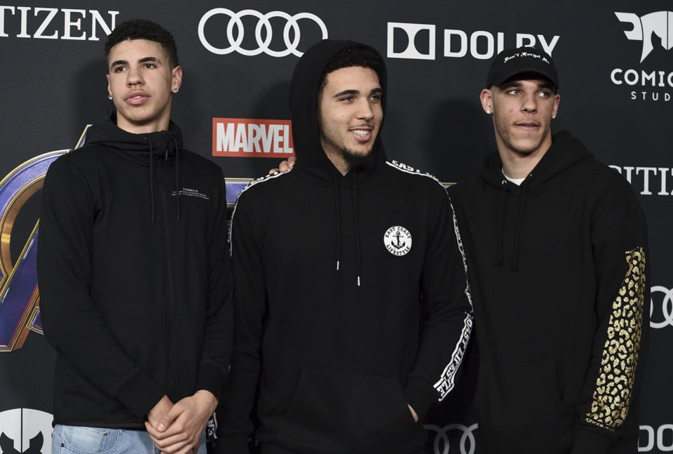 "Photo - Professional basketball player Lonzo Ball, of the Los Angeles Lakers, from right, and his brothers LiAngelo Ball and LaMelo Ball arrive at the premiere of ""Avengers: Endgame"" at the Los Angeles Convention Center on Monday, April 22, 2019. (Photo by Jordan Strauss/Invision/AP)"