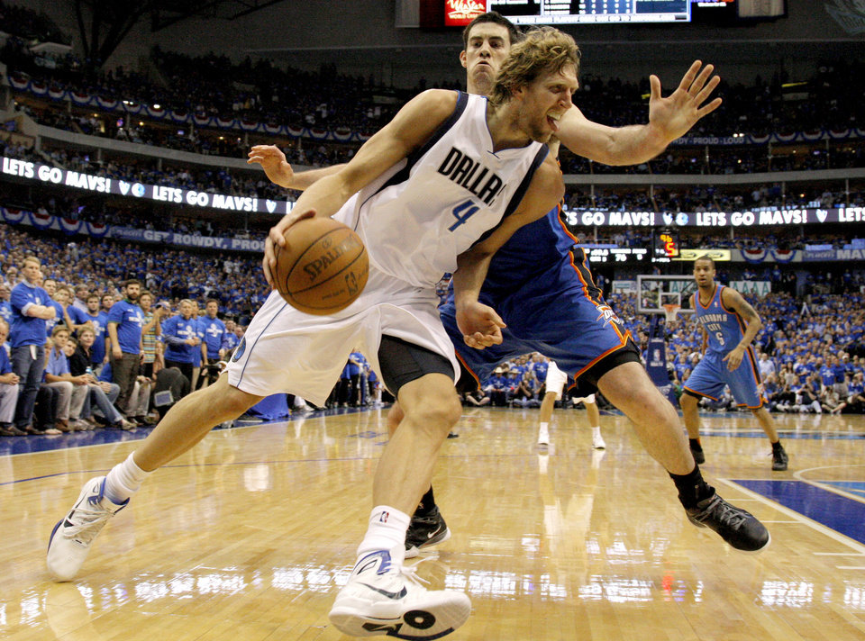 Dirk Nowitzki (41) of Dallas  drives past Oklahoma City's Nick Collison (4) during game 5 of the Western Conference Finals in the NBA basketball playoffs between the Dallas Mavericks and the Oklahoma City Thunder at American Airlines Center in Dallas, Wednesday, May 25, 2011. Photo by Bryan Terry, The Oklahoman