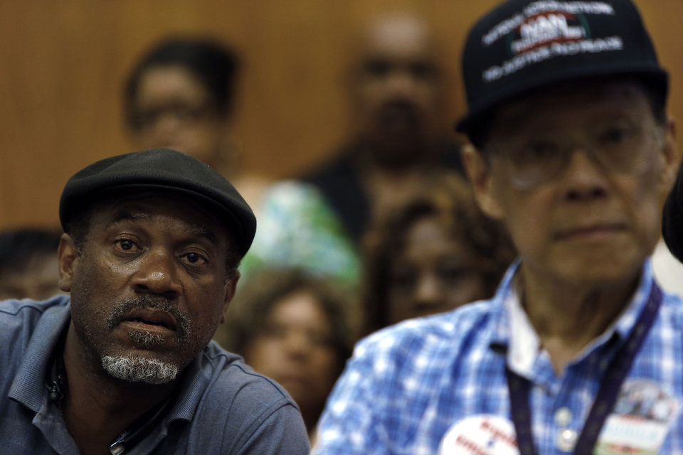 Photo - FILE - In this July 22, 2013 file photo Tony Brown, left, a Department of Transportation retiree, listens to union leaders speak in Detroit. Court documents show the city, which now hopes to emerge from bankruptcy, owes more than 100,000 creditors that include individual retirees, city workers, businesses, property owners and litigants. (AP Photo/Paul Sancya)