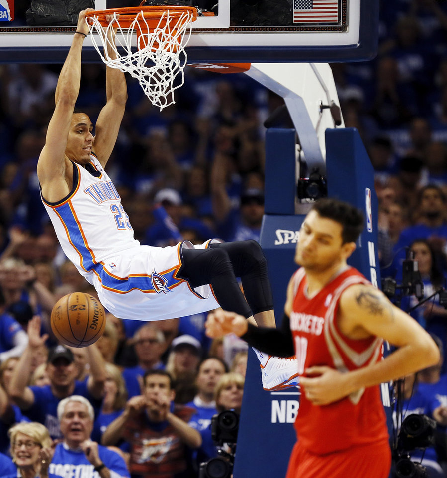 Photo - Oklahoma City's Kevin Martin (23) dunks in front of Houston's Carlos Delfino (10) during Game 1 in the first round of the NBA playoffs between the Oklahoma City Thunder and the Houston Rockets at Chesapeake Energy Arena in Oklahoma City, Sunday, April 21, 2013. Photo by Nate Billings, The Oklahoman