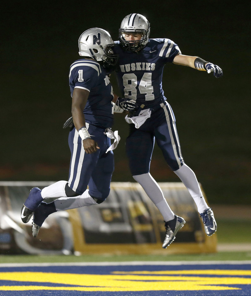 Photo - Edmond North's Michael Farmer, left, celebrates with Jarech Page after Farmer scored a touchdown during a high school football game against Midwest City at Wantland Stadium in Edmond, Thursday, October 25, 2012. Photo by Bryan Terry, The Oklahoman