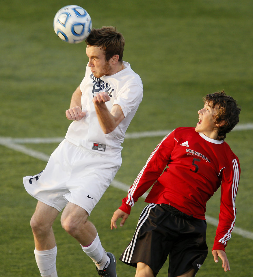 Photo - Heritage Hall's Will Snoody heads the ball beside Skiatook's Matt Schorrenberg during the Class 5A boys soccer championship between Heritage Hall and Skiatook in Norman, Okla., Friday, May 16, 2014. Photo by Bryan Terry, The Oklahoman