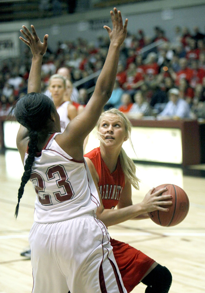 Photo - Washington's Dagan Lampkin looks for an opening around Spiro's Kanisha Hutchinson during the Class 3A Girls quarterfinal basketball game at Southern Nazarene University's Sawyer Center in Bethany, OK, Thursday, March 13, 2014,  Photo by Paul Hellstern, The Oklahoman