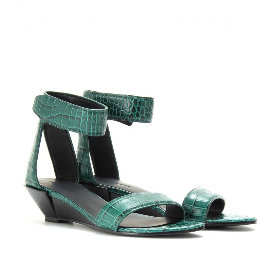 Photo - After color authority Pantone named emerald the official color of 2013, the green tone began popping up on runways and in stores everywhere. Here, Alexander Wang Vika Croco embossed wedge sandals, $743, MyTheresa.com. (Courtesy MyTheresa.com via Los Angeles Times/MCT)