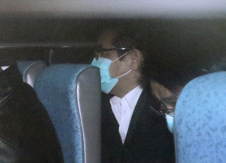 Photo - Hong Kong businessman Carson Yeung, also owner of Birmingham City football club, sits inside a police van while leaving Hong Kong's District court in Hong Kong Monday, March 3, 2014. Yeung was found guilty of money laundering by the Hong Kong District Court and was convicted over charges relating to his handling of 721 million Hong Kong dollars ($93 million) using five bank accounts between January 2001 and December 2007.  (AP Photo) HONG KONG OUT, NO ARCHIVE