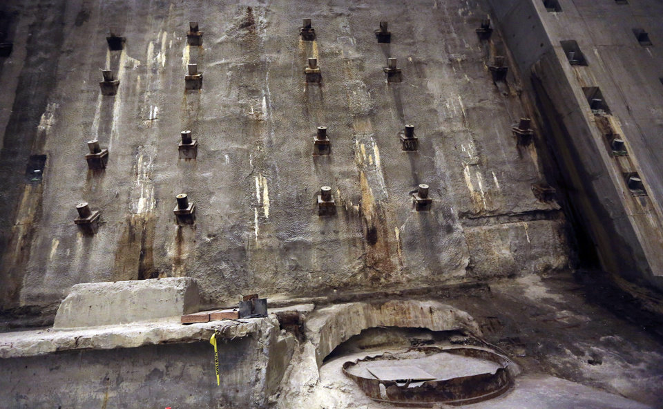 Photo - The slurry Wall, part of the World Trade Center's original foundation, is seen during a media tour of the National September 11 Memorial and Museum, Friday, Sept. 6, 2013 in New York. Construction is racing ahead inside the museum as the 12th anniversary of the Sept. 11, 2001 attacks draws near. Several more large artifacts have been installed in the cavernous space below the World Trade Center memorial plaza. (AP Photo/Mary Altaffer)
