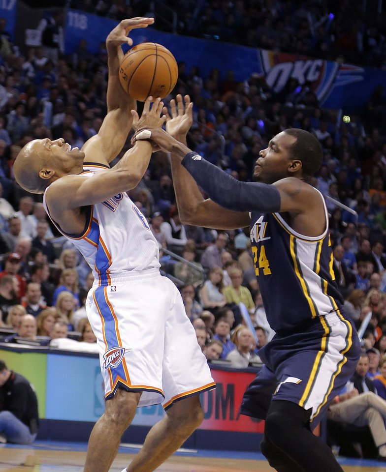 Photo - Oklahoma City Thunder's Derek Fisher (6) and Utah Jazz's Paul Millsap (24) battle for a loose ball during the NBA basketball game between the Oklahoma City Thunder and the Utah Jazz at Chesapeake Energy Arena on Wednesday, March 13, 2013, in Oklahoma City, Okla. Photo by Chris Landsberger, The Oklahoman