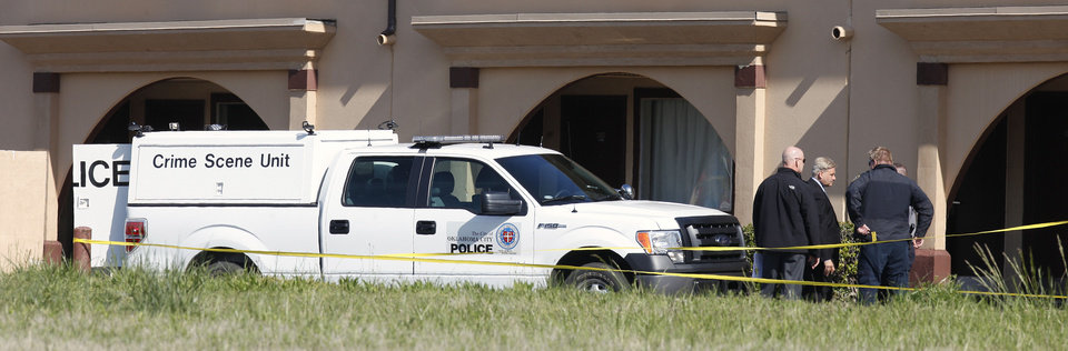 Photo - Oklahoma City police process the scene Thursday of a double stabbing of two women at the Quality Inn Southwest, 7800 C.A. Henderson Blvd., in Oklahoma City. Photo by Paul B. Southerland, The Oklahoman