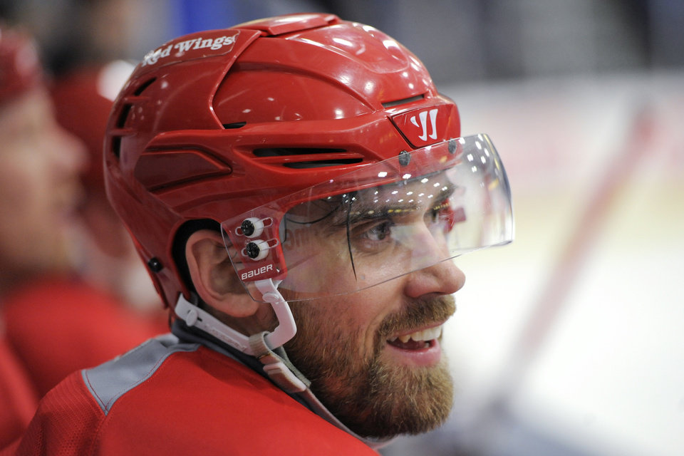 Photo - Detroit Red Wings' Henrik Zetterberg takes a breather on the bench during the NHL hockey team's training camp Sunday, Jan. 13, 2013, in Plymouth, Mich. (AP Photo/The Detroit News, David Guralnick) DETROIT FREE PRESS OUT  HUFFINGTON POST OUT  MAGS OUT