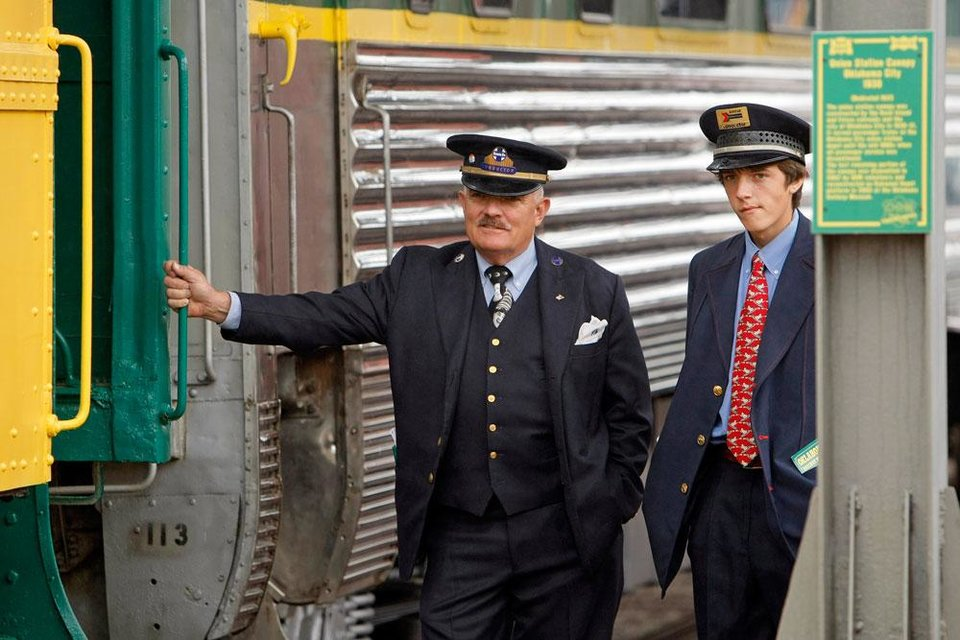Photo -  Assistant conductors Steve Davis, left, and son Michael Davis wait for passengers to start boarding for a train ride at the Oklahoma Railway Museum, 3400 NE Grand Blvd., in Oklahoma City, Saturday, April 7, 2012. The museum gives train rides the 1st and 3rd Saturday from April through August.  Photo by Nate Billings, The Oklahoman