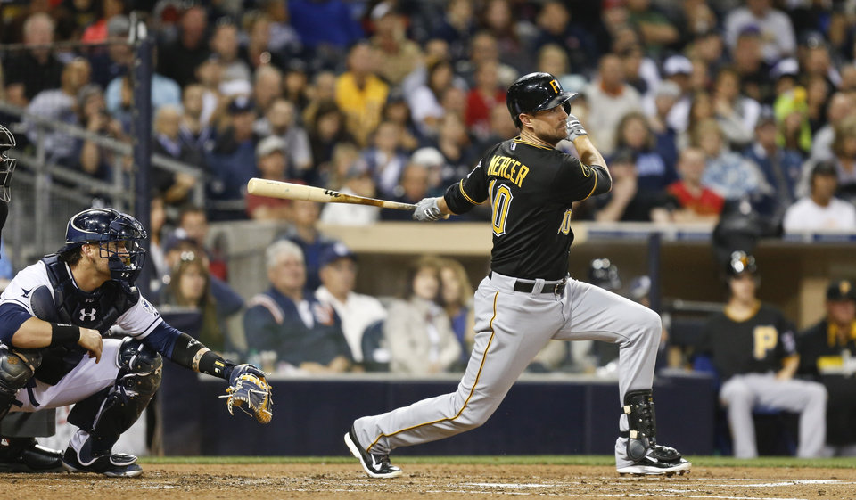 Photo - Pittsburgh Pirates' Jordy Mercer watches his line drive single to center that drives in Starling Marte during the fourth inning of a baseball game Monday, June 2, 2014, in San Diego. (AP Photo/Lenny Ignelzi)