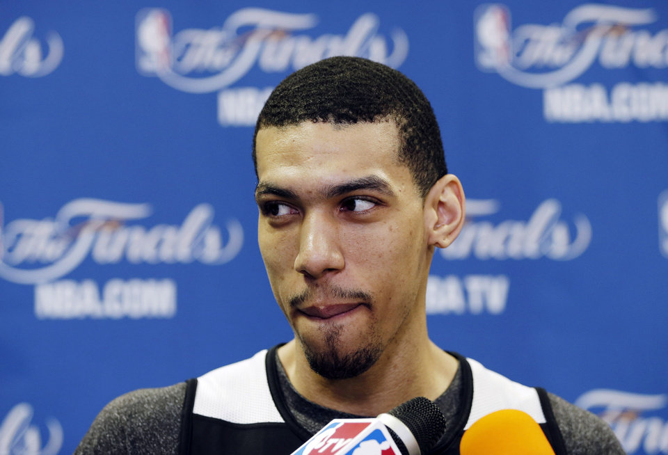 Photo - San Antonio Spurs' Danny Green takes questions during a media availability after NBA basketball practice, Saturday, June 15, 2013, in San Antonio. The Spurs host the Miami Heat in Game 5 of the NBA Finals on Sunday, with the best-of-seven games series even at 2-2. (AP Photo/David J. Phillip)