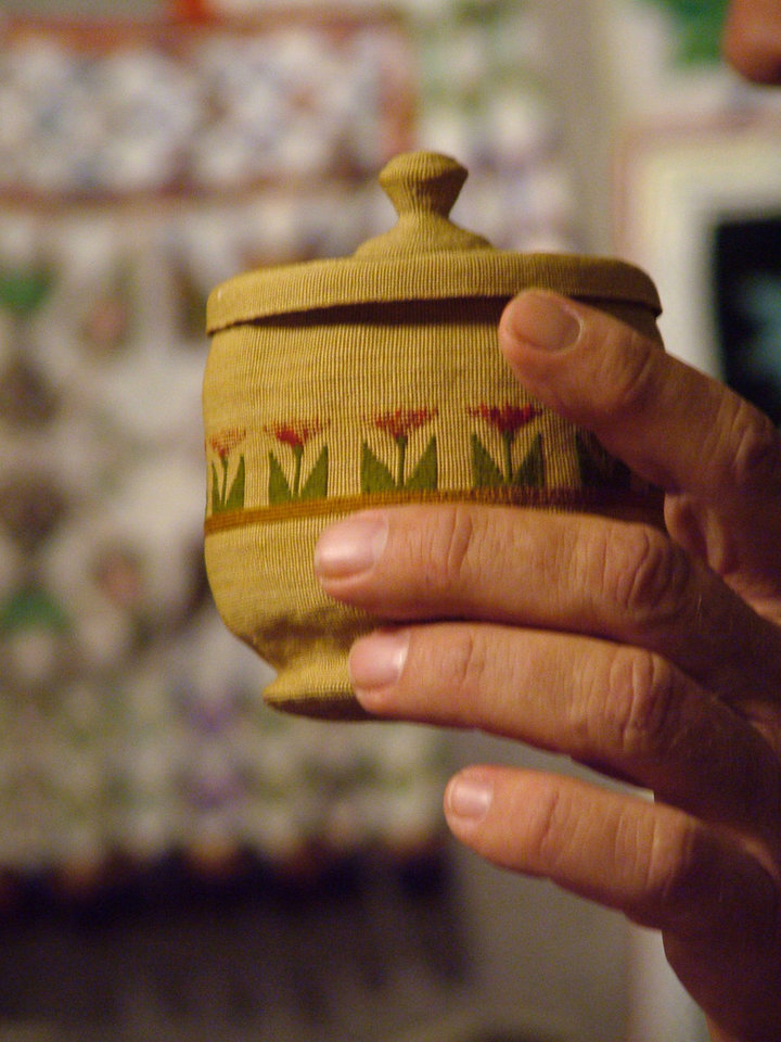 This tiny finely made basket was woven of grass by Native American Atu. The lidded basket with floral decoration is owned by Ronny Smithee. Smithee discussed Native American artifacts and art with the Harrah Historical Society.<br/><b>Community Photo By:</b> Lin Archer<br/><b>Submitted By:</b> Lin,