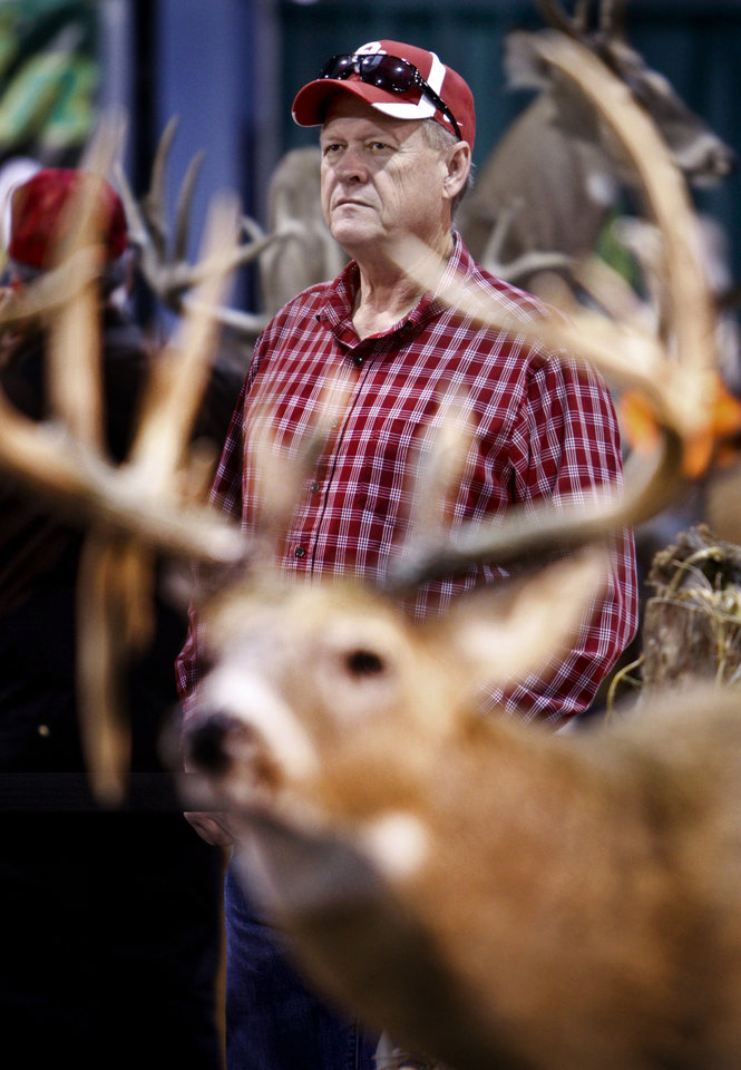 Steve Center of Jones, Okla. looks at a taxidermy booth during the Backwoods Hunting and Fishing Show on Friday, Feb. 24, 2012 in Oklahoma City, Okla.  Photo by Chris Landsberger, The Oklahoman