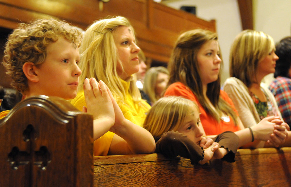 Blessed Sacrament Catholic Church parishioners attend an Ash Wednesday Mass at the church in Jonesboro, Ark., on Wednesday, Feb. 22, 2012. The photo includes Cross Jumper (from left), Alison Jumper, Reece Jumper, Ashley Davis and Katie Blevins. (AP Photo/The Jonesboro Sun, Saundra Sovick)