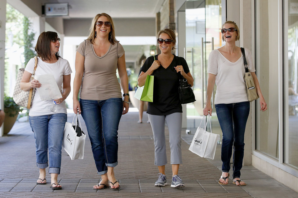 Photo - Shoppers walk in front of stores at the Biltmore Fashion Park on Thursday, May 1, 2014, in Phoenix.  Consumer spending soared 0.9 percent in March, the government said Thursday, the most in 4½ years. (AP Photo/Ross D. Franklin)