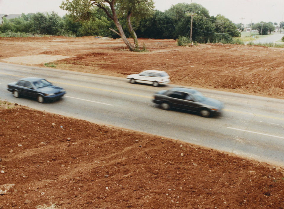 Photo - Graffiti Ghost - An area around NW 59 and Western Avenue has changed tremendously since work was completed to destroy the Graffiti Bridge, which once drew many Oklahoma City and Edmond residents to paint on it.  (For more information, see original photo).  Staff photo by Doug Hoke.  Photo dated 07/20/1991 and published on 07/31/1991 in The Daily Oklahoman(C).  Published on 08/07/1991 in The Daily Oklahoman(C).