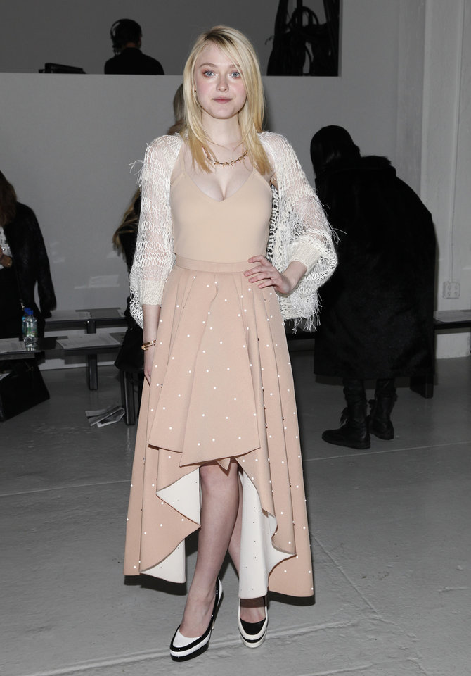 Photo - Actress Dakota Fanning attends the Rodarte 2014 Fall/Winter Collection during Mercedes Benz Fashion Week on Tuesday, Feb. 11, 2014, in New York. (Photo by Amy Sussman/Invision/AP)