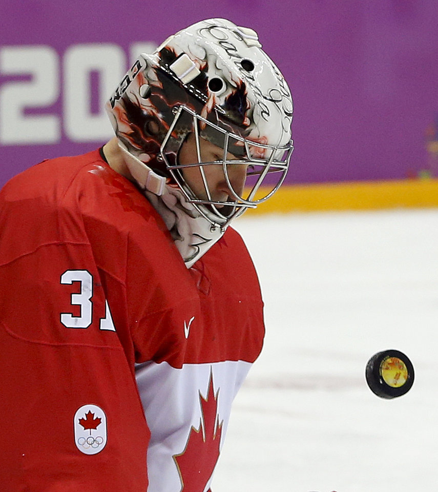 Photo - Canada goaltender Carey Price blocks a shot by Sweden during the first period of the men's gold medal ice hockey game at the 2014 Winter Olympics, Sunday, Feb. 23, 2014, in Sochi, Russia. (AP Photo/Julio Cortez)