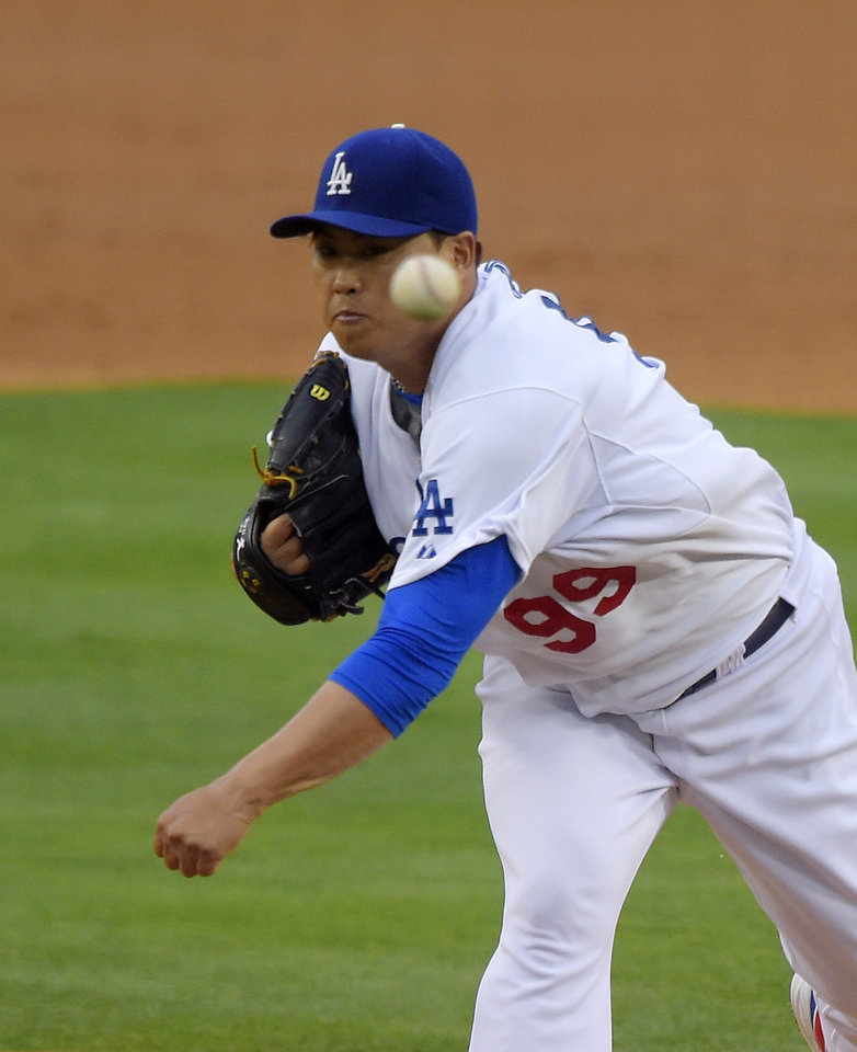 Photo - Los Angeles Dodgers starting pitcher Hyun-Jin Ryu, of South Korea, throws to the plate during the second inning of a baseball game against the Chicago Cubs, Saturday, Aug. 2, 2014, in Los Angeles. (AP Photo/Mark J. Terrill)
