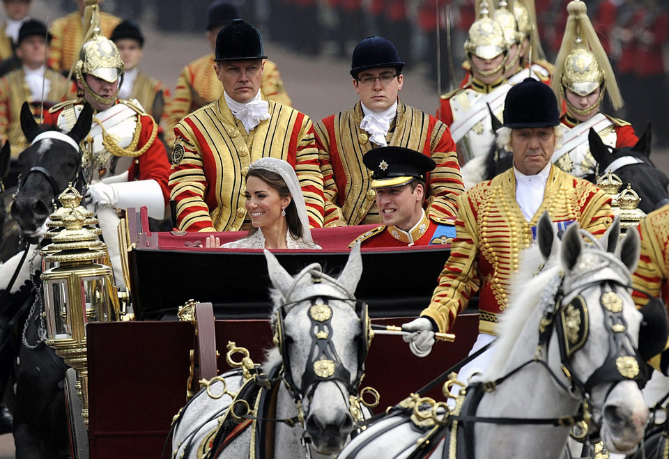 Photo - Britain's Prince William, center right, and his wife Kate, Duchess of Cambridge, center left, travel down the Mall along the procession route to Buckingham Palace after their wedding ceremony at Westminster Abbey, central London, Friday, April 29, 2011. (AP Photo/PA, Rebecca Naden) UNITED KINGDOM OUT, NO SALES, NO ARCHIVE ORG XMIT: RWDA131