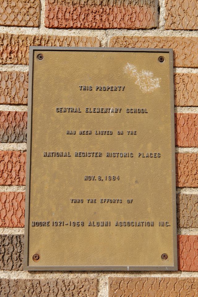 Photo - This plaque is posted at the entrance to the 1928 Moore school building.