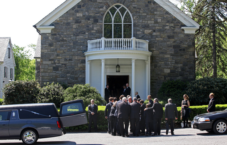 Photo -   Members of Mary Richardson Kennedy's family remove the casket holding her, the estranged wife of Robert F. Kennedy Jr., at St. Patrick's Church in Bedford, N.Y., Saturday, May 19, 2012. Kennedy was found dead of an apparent suicide this week at her home in Bedford. (AP Photo/Craig Ruttle)