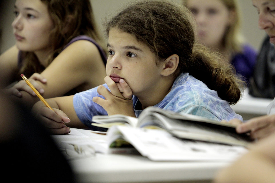 Chloe Buck, 11 from Palm Harbor, Flor. listens as teens participating in a comic book character workshop led by Jennifer Johnson from University of Oklahoma (OU) Writing Center on Tuesday, June 26, 2012, in Norman, Okla.  Photo by Steve Sisney, The Oklahoman