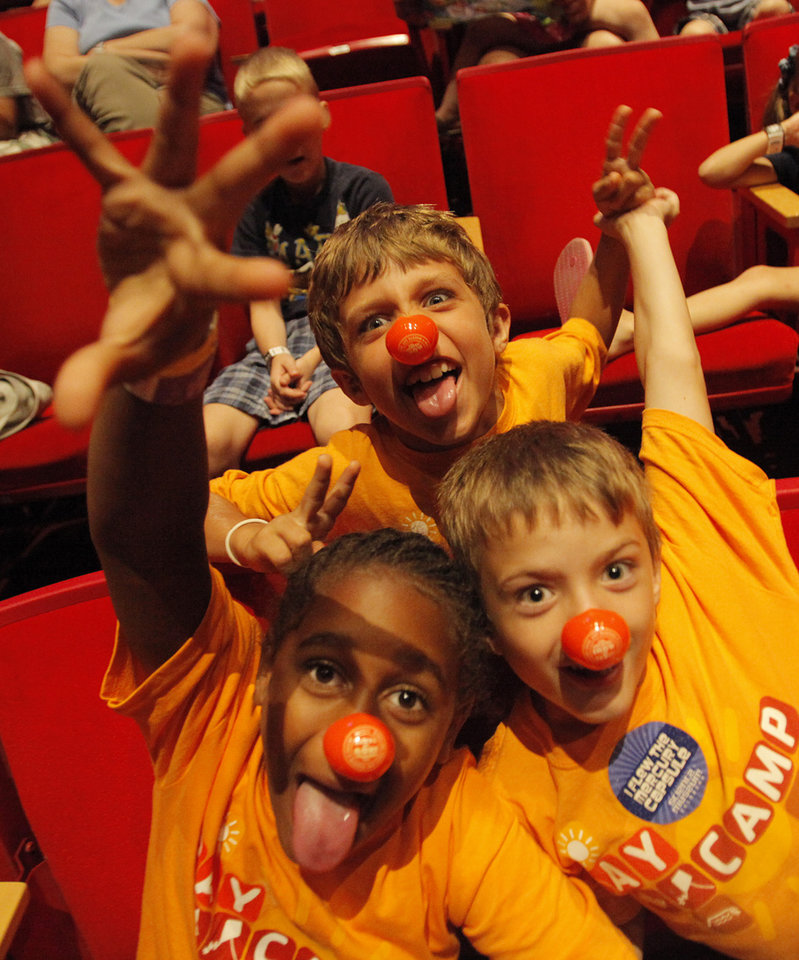 Brendan Barnes, 8, Wesley Canfield, 9, and Parker McGlothlin, 9, poses for a photo wearing their clown noses before a Science Live show at the Science Museum of Oklahoma, Wednesday, June 27, 2012. Ringling Bros. clowns showed viewers the science behind circus performance. Photo by Garett Fisbeck, The Oklahoman
