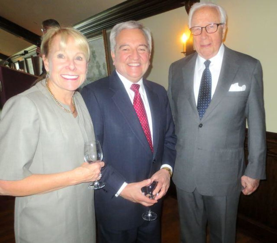 """Lana and Dave Lopez talk with David McCullough at the Literary Voices Dinner. Guests enjoyed the theme """"Reading is your passport to Adventure"""" with globes, roses, passports and books as centerpieces and David McCullough as speaker. The Pulitzer Prize winner's  latest book """"The Greater Journey: Americans in Paris"""" added special emphasis to the theme. """"I try to make you see, hear, feel and smell,"""" the author noted.  Carol Troy was Literary Voices event chairman and Elaine Levy was co-chairman.  Robert Clement is Library Endowment Trust president. The Library Endowment Trust officers and trustees were hosts for the event.  Friends of the Metropolitan Library were given the Lee B. Brawner Lifetime Achievement Award. (Photo by Helen Ford Wallace)."""