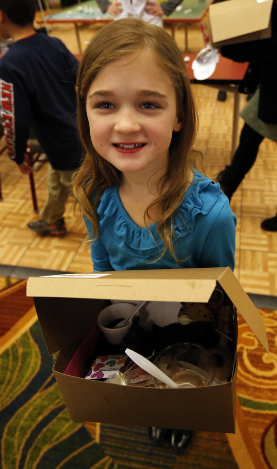 Helena Martins, 9, carries her box of hand picked chocolate at the Firehouse Art Center's annual Chocolate Festival on Saturday, Feb. 2, 2013 in Norman, Okla.  Photo by Steve Sisney, The Oklahoman