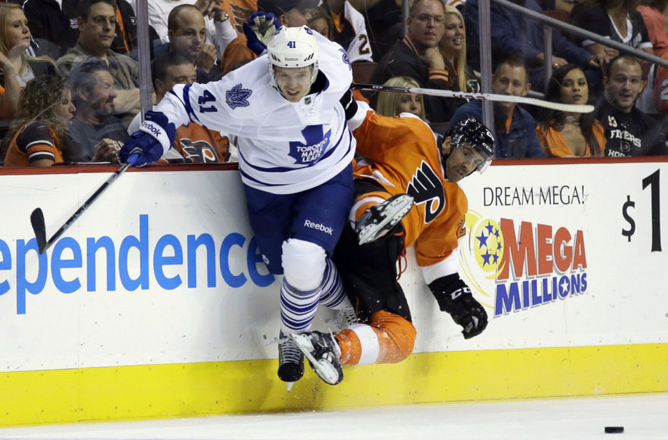 Photo - FILE - In this Oct. 2, 2013, file photo, Toronto Maple Leafs' Nikolai Kulemin, left, of Russia, collides with Philadelphia Flyers' Maxime Talbot during the first period of an NHL hockey game in Philadelphia, Pa. For the first time since 1973, there is just one Canadian team in the NHL postseason. The Montreal Canadiens represent the nation's only hope of ending a 21-year Stanley Cup drought. (AP Photo/Matt Slocum, File)