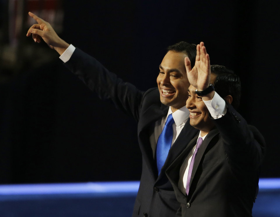 Photo - San Antonio Mayor Julian Castro, left, and his brother Joaquin Castro, San Antonio Mayor Julian Castro's brother, wave at delegates at the Democratic National Convention in Charlotte, N.C., on Tuesday, Sept. 4, 2012. (AP Photo/Lynne Sladky)  ORG XMIT: DNC509