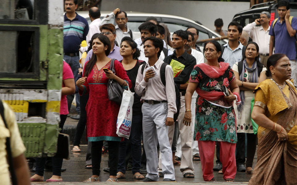 Photo -   Commuters wait for buses outside a Metro station after Delhi Metro rail services were disrupted following power outage in New Delhi, India, Tuesday, July 31, 2012. A massive blackout hit northern and eastern India on Tuesday afternoon, leaving 600 million people without electricity in one of the world's most widespread power failures. The outage came just a day after India's northern power grid collapsed for several hours leaving cities and villages across eight states powerless.(AP Photo/ Rajesh Kumar Singh)