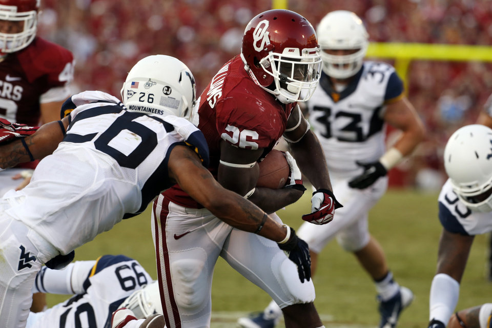 Photo - Oklahoma's Damien Williams (26) carries to the half yard line during a college football game between the University of Oklahoma Sooners (OU) and the West Virginia University Mountaineers at Gaylord Family-Oklahoma Memorial Stadium in Norman, Okla., on Saturday, Sept. 7, 2013. Photo by Steve Sisney, The Oklahoman