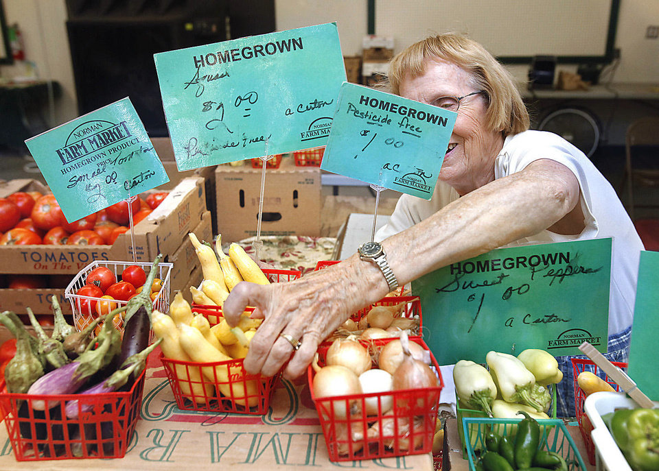 Photo - Juanola Garriott sets out produce at the Farmer's Market at the Cleveland County Fairgrounds on Saturday, July 16, 2011, in Norman, Okla.   Photo by Steve Sisney, The Oklahoman ORG XMIT: KOD