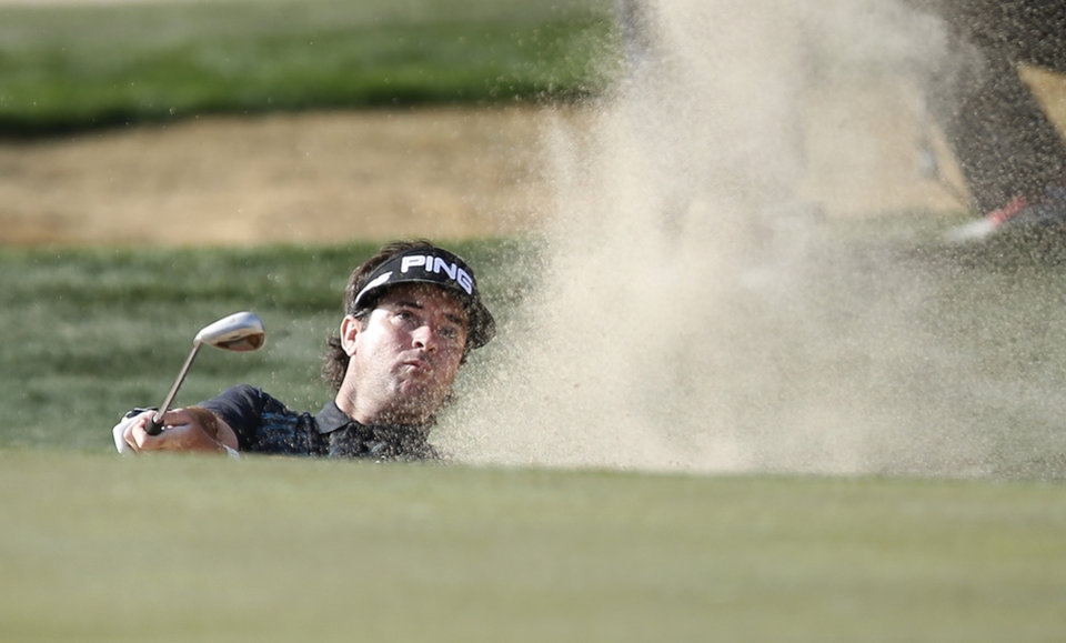 Photo - Bubba Watson hits out of a bunker at the 16th green during the final round of the Phoenix Open golf tournament on Sunday, Feb. 2, 2014, in Scottsdale, Ariz. (AP Photo/Ross D. Franklin)