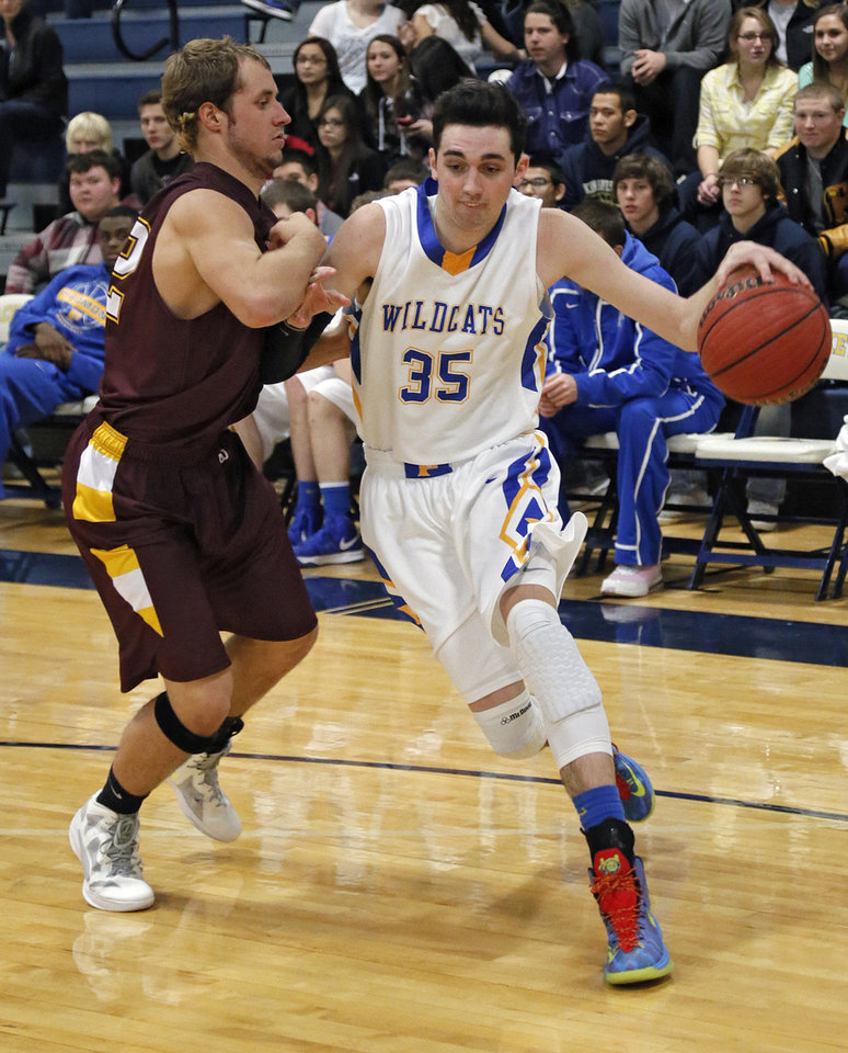 Piedmont's Grant Gipson (35) drives past Clinton's Bowman Vowell (42) during a basketball tournament at the Kingfisher High School gym on Thursday, Jan. 24, 2013, in Kingfisher, Okla.  Photo by Chris Landsberger, The Oklahoman