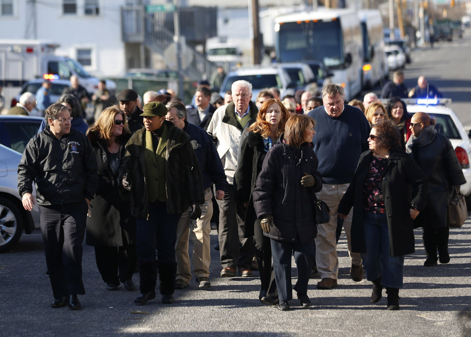Members of the New Jersey General Assembly walk toward the Seaside Heights boardwalk to look at the damage caused by Superstorm Sandy during a tour of the New Jersey Shore, Thursday, Nov. 29, 2012, in Seaside Heights, N.J. (AP Photo/Julio Cortez)
